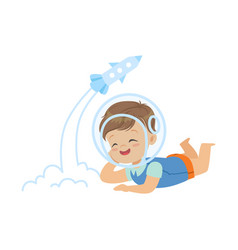 sweet little boy in the astronauts helmet lying on vector image