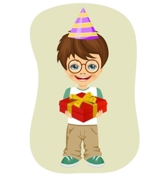 boy with party hat holding birthday gift vector image vector image