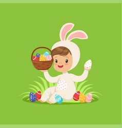 cute little boy in a white bunny costume holding vector image