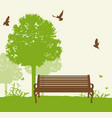 bench under a green tree vector image vector image