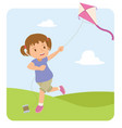 happy little girl playing kite in the field vector image vector image