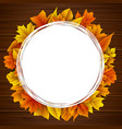 round frame with autumn leaves wooden background vector image vector image
