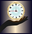 a gold watch hanging over the hand vector image