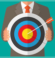 business man holding a dart board with a direct vector image