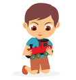 happy young boy playing his red toy train vector image vector image