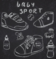 Baby shoes set sketch handdrawn on blackboard vector image