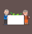 elderly couple holding blank white board happy vector image