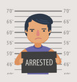 photo man arrested with sign in police station vector image vector image