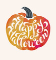 brush calligraphy Happy Halloween within a pumpkin vector image