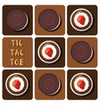cup cake and cookie in tic-tac-toe game vector image vector image