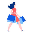 woman walking with purchase buy paper bags vector image