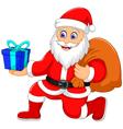 cute santa claus cartoon holding a gift vector image vector image
