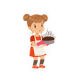 sad girl holding a burnt freshly baked pie vector image vector image