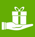 gift box in hand icon green vector image vector image