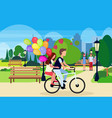 couple in love riding bicycle with colorful air vector image vector image