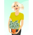smiling woman holding peperomia marmorata vector image vector image