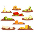 cartoon fruits on wooden cutting board on white vector image