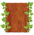 Wooden board with green leaves vector image