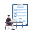 worker using laptop goals list with ticks vector image