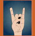 rock hand gesture on blue grunge background vector image