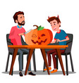 father and son making a pumpkin for halloween vector image