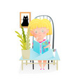 little girl reading a book sitting at desk in room vector image
