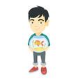 asian boy holding aquarium with goldfish vector image vector image