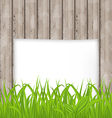 Green grass and paper sheet on wooden texture vector image vector image