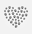 dark cat footprints in heart shape vector image