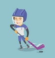 Young caucasian ice hockey player with a stick