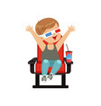 cute little boy in 3d glasses sitting on a red