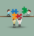 teamwork business men assembling pieces of a vector image vector image