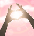 Hands in the form of heart over pink sky Concept vector image