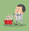 businessman with money on cart vector image vector image