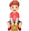 cute little boy sitting on a cube vector image vector image