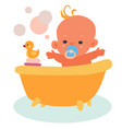 happy baby bathes in a bath with a yellow rubber vector image vector image