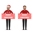 man with a poster of merry christmas standing in vector image vector image