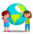 two girls child holding the earth vector image