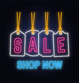 winter sale neon sign with christmas tag hanging vector image