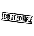 square grunge black lead by example stamp vector image vector image