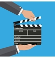 Black opened clapperboard in hands vector image vector image