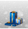 christmas gifts with falling snow blue vector image vector image