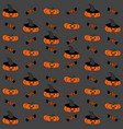 seamless halloween pattern with pumpkins on black vector image