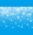snow and snowflakes on blue background christmas vector image