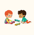 two cute boys playing with their vector image
