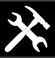 wrench and hammer it is the white color icon vector image