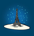 eiffel tower in winter snowing vector image