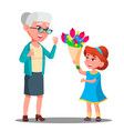 little girl giving flowers to grandmother vector image