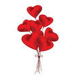 Red heart shaped balloons of love on white