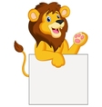 Happy lion cartoon holding blank sign vector image vector image